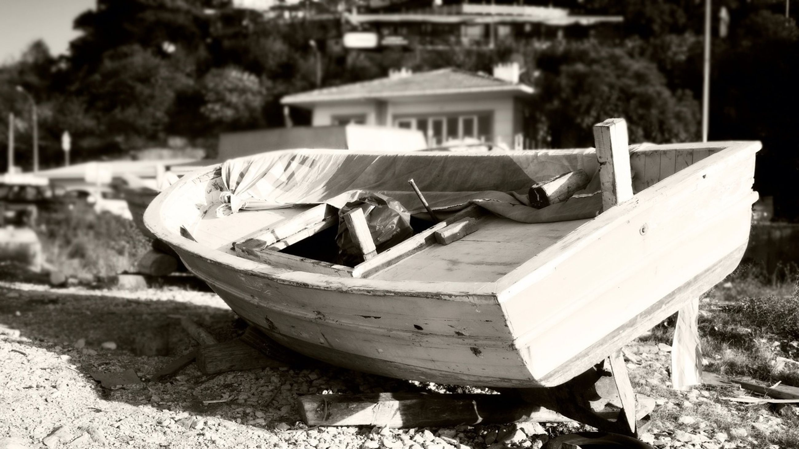 transportation, boat, moored, abandoned, nautical vessel, mode of transport, damaged, focus on foreground, obsolete, field, day, outdoors, wood - material, close-up, no people, old, absence, nature, tree, broken