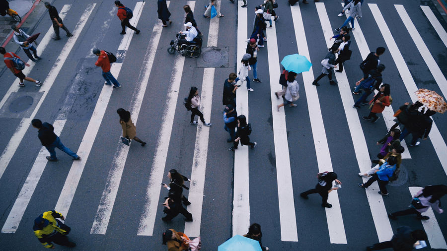 Architecture Busy City City Life City Street Commuter Crossing Crosswalk Crowd Crowded Group Of People High Angle View Large Group Of People Motion Outdoors Pedestrian Real People Road Road Marking Street Transportation Walking Zebra Crossing