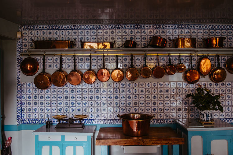 Utensils hanging against wall in kitchen