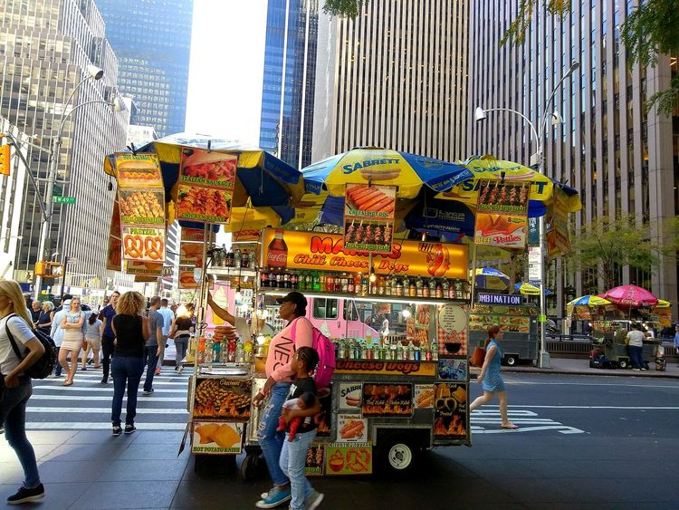 Hot dog vendor.photo by Shell Sheddy Been There. The Week On EyeEm Sheshephoto Shellsheddyphotography Hot Dog Vendor City City Street City Life Consumerism Architecture Marketplace Skyscraper City Landscape Hot Dog Stand Walking Around Architecture Market City Life Street City Street City Food And Drink Market Paint The Town Yellow Done That. Be. Ready. Food Stories The Graphic City