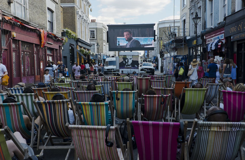 People watch a movie on an outdoor screen in Portobello Road on 8th of July 2018 in London, United Kingdom. Britain is in the middle of a boom in outdoor cinema. (photo by Lorenzo Grifantini) London MOVIE Portobello Market Arts Culture And Entertainment Group Of People Outdoor Cinema Outdoors Portobello Streetphotography