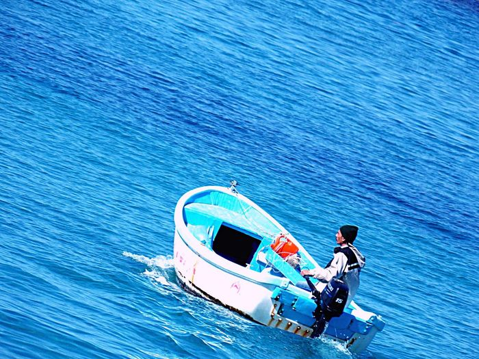 Sea Water Real People Leisure Activity Transportation Nautical Vessel One Person Mode Of Transport Men Outdoors Nature Occupation Beauty In Nature Day Adults Only Adult People One Man Only Alexandria Egypt