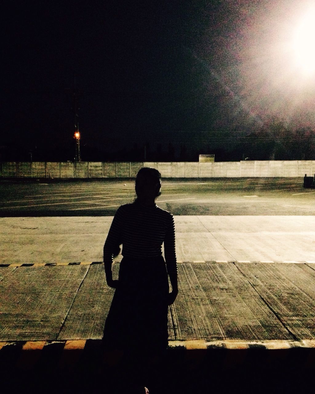 night, one person, real people, outdoors, shadow, silhouette, leisure activity, standing, illuminated, clear sky, men, sky, people