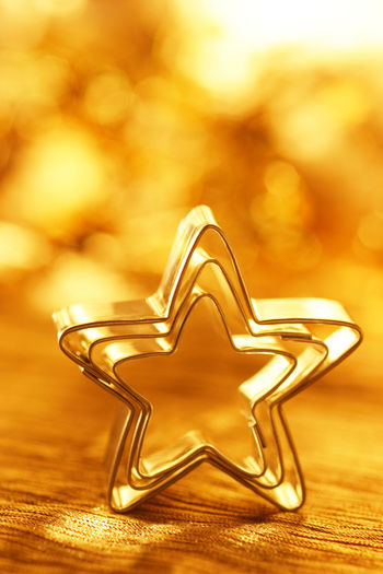 Close-up of star shape cookie cutters on table