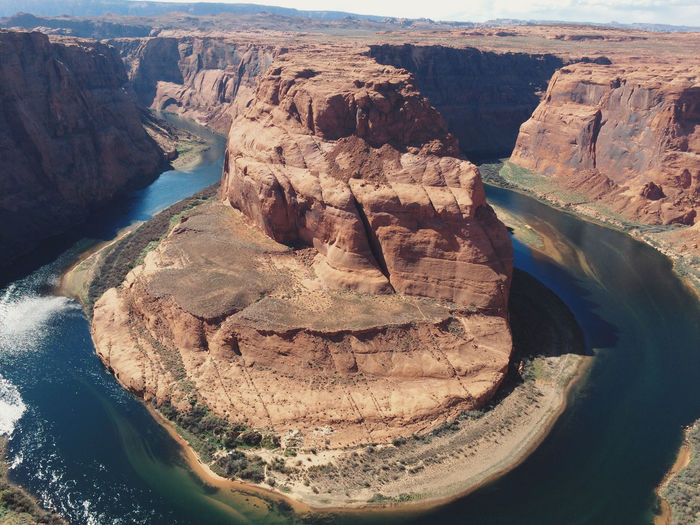 High angle view of horseshoe bend and river on sunny day