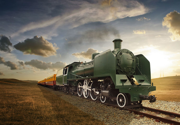 Cloud - Sky Day Landscape Locomotive Mode Of Transport Nature No People Outdoors Public Transportation Rail Transportation Railroad Track Sky Steam Train Sunset Train - Vehicle Transportation