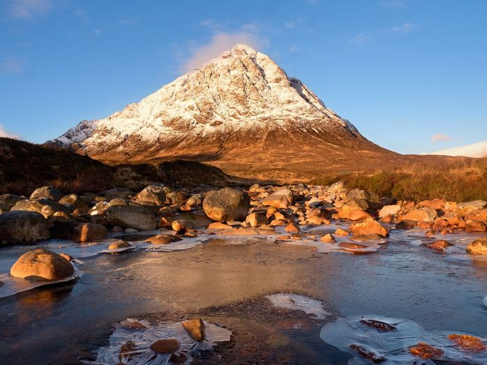 Higland in scotland an marvelous day. snowy cone of mountain stob dearg 1021 metres high. spring day