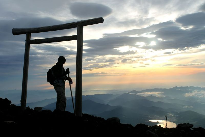 Silhouette Man On Mount Fuji At Sunrise