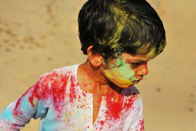 Colorfull boy, face paint, play holi,