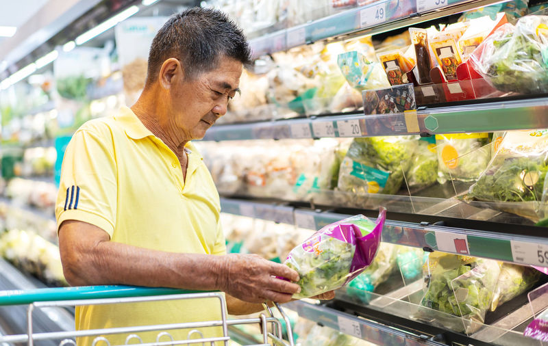 Midsection of man having food in store
