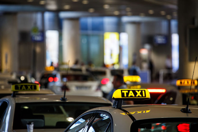 Public Transportation Taxi Traffic Jam Travel Traveling Waiting Airport Cab Car Close-up Communication Crowded Focus On Foreground Illuminated Land Vehicle Lane Mode Of Transport Night No People Outdoors Problems Real People Street Text Transportation Fresh On Market 2017