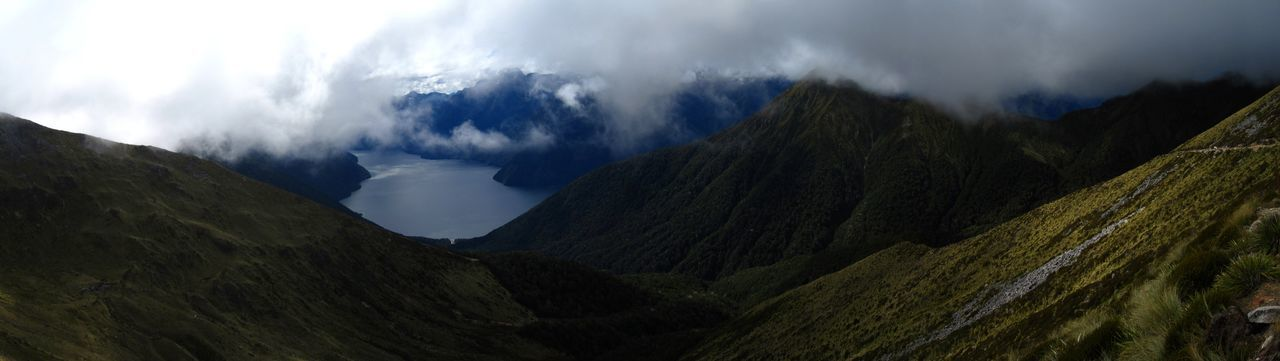 Mountain Cloud - Sky Scenics - Nature Panoramic Sky Mountain Range Beauty In Nature Nature Environment Landscape Land No People Tranquility Valley Travel Destinations Mountain Peak Outdoors Tranquil Scene Rock New Zealand Panorama