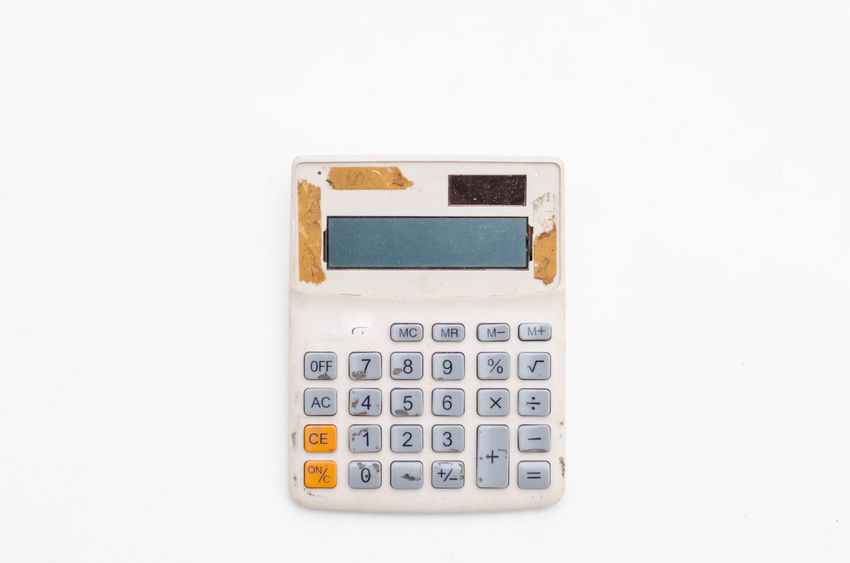 old calculator isolated on white background old vintage dirty keyboard calculator Accuracy Break Business Calculator Calculator Machine Calculators Communication Copy Space Cut Out Dirty Economy Finance Mathematics No People Number Old Order Single Object Studio Shot Technology White Background White Color