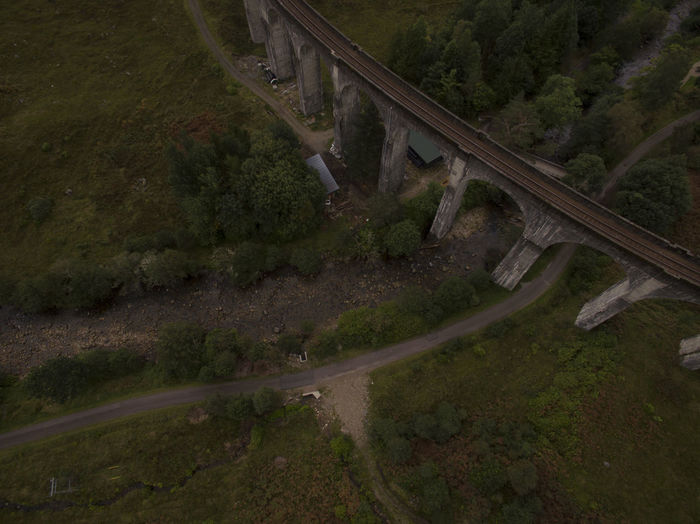 Aerial View Of Train On Bridge Over Landscape