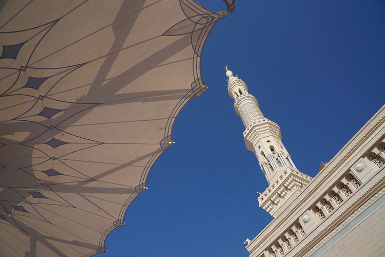 Low angle view of al-masjid an-nabawi against clear sky
