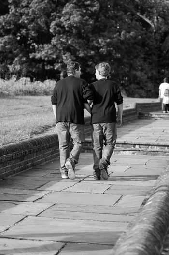 Two Brothers Walking Together in Black & White Black & White Family Black And White Bonding Boys Casual Clothing Full Length Lifestyles Men Nature Outdoors People Real People Rear View Togetherness Two People Walking
