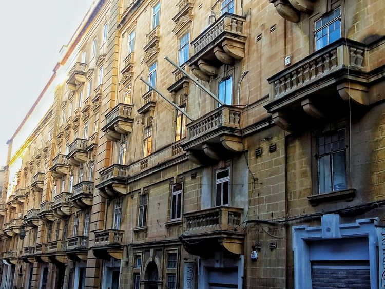 Perspective in valletta olden buildings Building Exterior Architecture Built Structure Low Angle View No People Outdoors Day City Sky Perspective Valletta,Malta Maltese Lovinmalta Malta Architecture Cityscape Sunnyday Hot Day Architectural Feature Travel Destinations City Clear Sky Sunny Ground Full Length