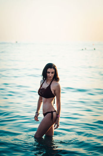 EyeEm Selects Sea Adult One Person Beach Summer Long Hair Young Adult Portrait Beautiful People Fashion Beauty People Only Women Vacations One Woman Only Young Women Outdoors Beautiful Woman Bikini Front View
