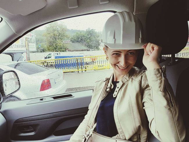 One Woman Only Headwear Transportation Business Finance And Industry Hardhat  Safety Helmet Construction Worker Beautiful Woman Fooling Around Having Fun In Car Shot Rainy Day Smiling Woman Smiling Crash Helmet Construction Equipment PhonePhotography Me Having Fun EyeEmNewHere Investing In Quality Of Life Car Be. Ready. Stories From The City