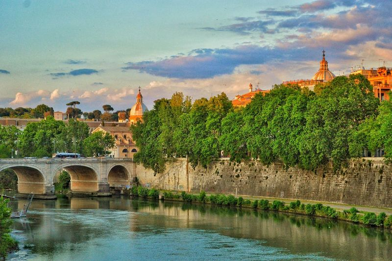 """Ponte Cavour and Beyond"" - Fiume Tevere, Roma Rome Roma Photobydperry Water Cloud - Sky Outdoors Sky No People River Day Tree Nature Tevere Tevere River Pontecavour Domes Evening Evening Sky Evening Light Moving Around Rome"