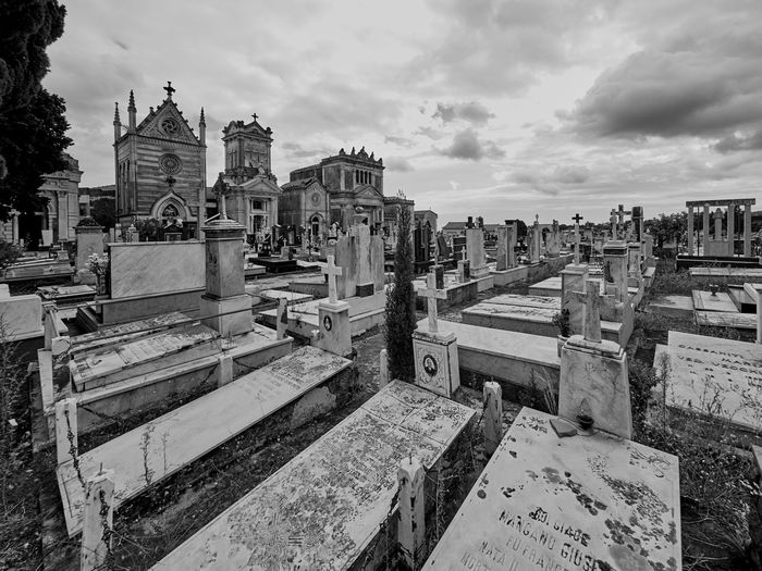Panoramic view of cemetery against sky in city