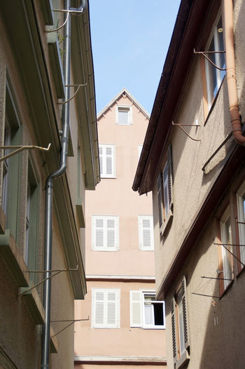 Low angle view of houses against clear sky