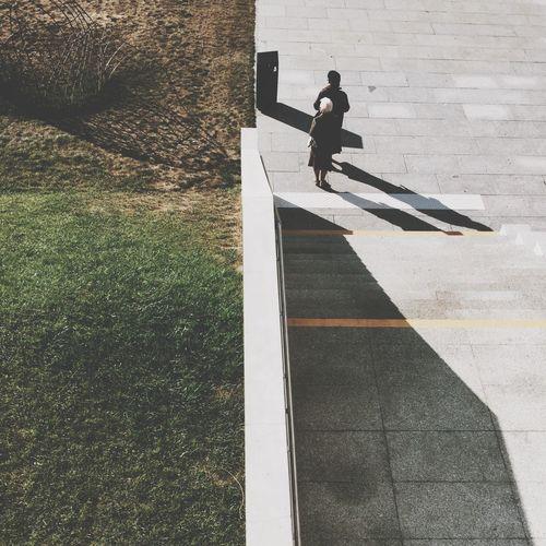 Shadow of woman on wall