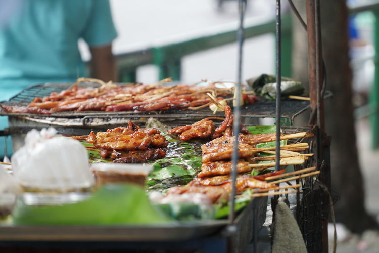 Close-up of meat cooking on barbecue grill