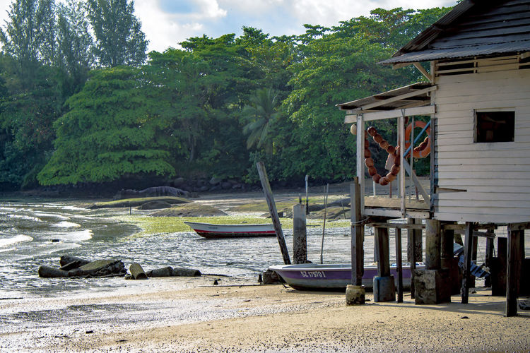 On the shores of Pulau Ubin, Singapore. Architecture Beach Beauty In Nature Building Exterior Built Structure Day Moored Mountain Nature Nautical Vessel No People Outdoors Pulauubin Scenics Singapore Singapore Life Sky Tranquility Tree Tropical Island Tropical Paradise Water