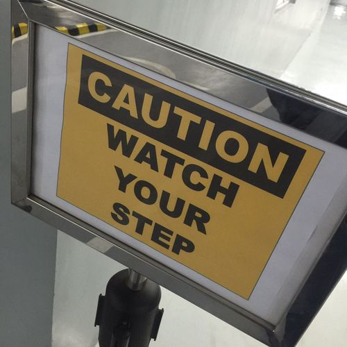 Watch your step Steps Watch Signage High Angle View Safety Stanchion Warning Warning Sign Caution Text Western Script Sign Communication Information Sign Information Capital Letter No People Warning Sign Guidance Indoors  Safety Directional Sign Message Yellow Road Sign