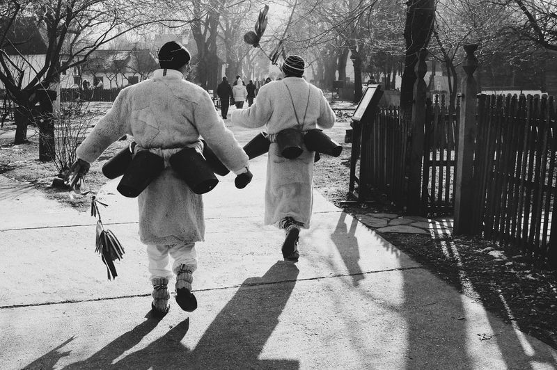 Old Way Of Life Traditional Culture Traditional Clothing Winter Holidays Shadow Sunlight Rear View Outdoors Togetherness Walking Two People