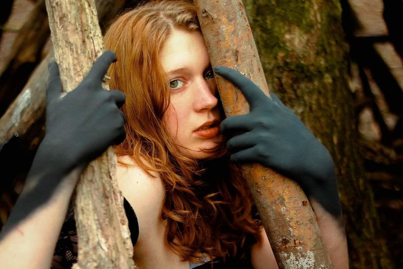 Portrait Of Scared Young Woman Against Tree