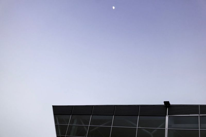 Copy Space Clear Sky Low Angle View Solar Energy Solar Panel Built Structure Architecture No People Nature Outdoors Moon Moonlight Twilight Evening Sky Evening Light Evening Glass - Material Glass Building Building Exterior Modern Modern Architecture Violet Sky Break The Mold The Architect - 2017 EyeEm Awards