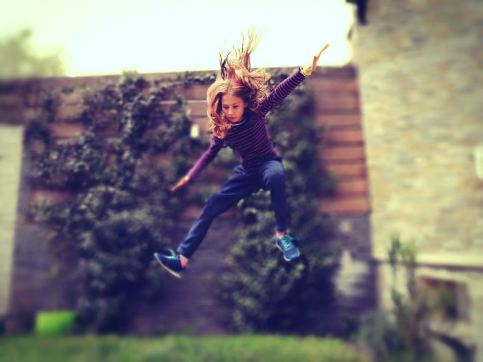 Young woman jumping outdoors