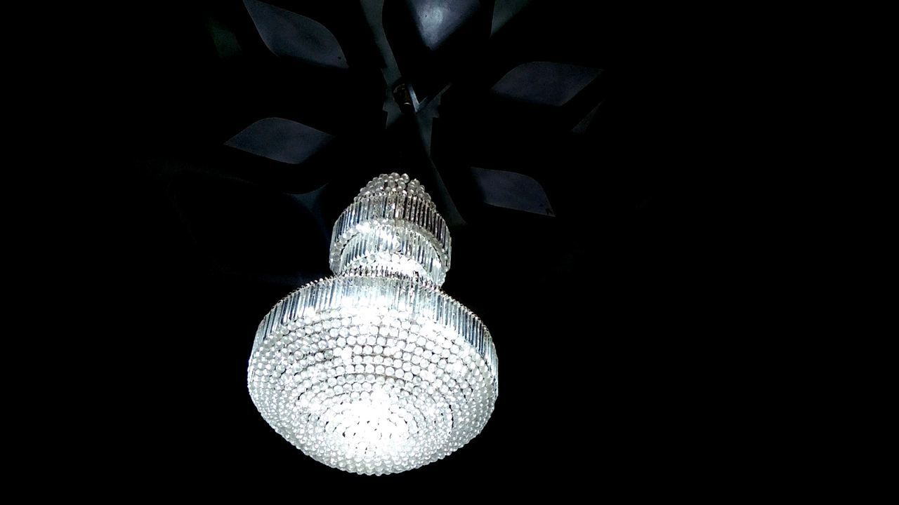 LOW ANGLE VIEW OF ILLUMINATED LIGHTING EQUIPMENT HANGING AGAINST CEILING