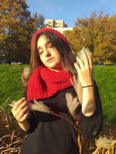 Woman with eyes closed standing in park during autumn