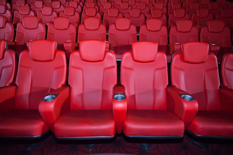 Empty Red Chairs At Theater