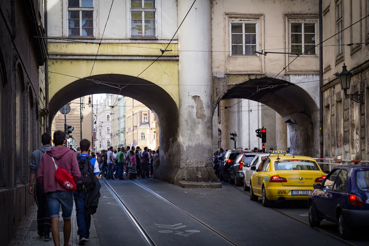 People And Cars On Street Amidst Buildings