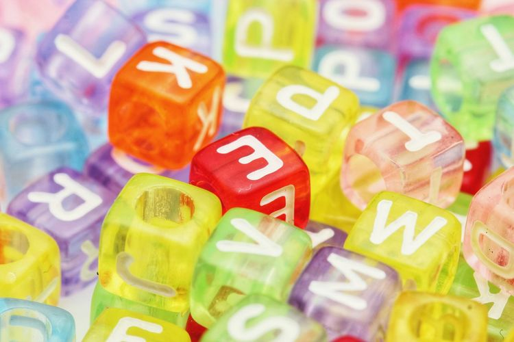 Close up of beads Beads Macro Object Background Multi Colored Backgrounds Business Finance And Industry Currency Business Vibrant Color Toy Block Cube Shape Block Shape Cubicle Alphabet Various Display Soft Focus