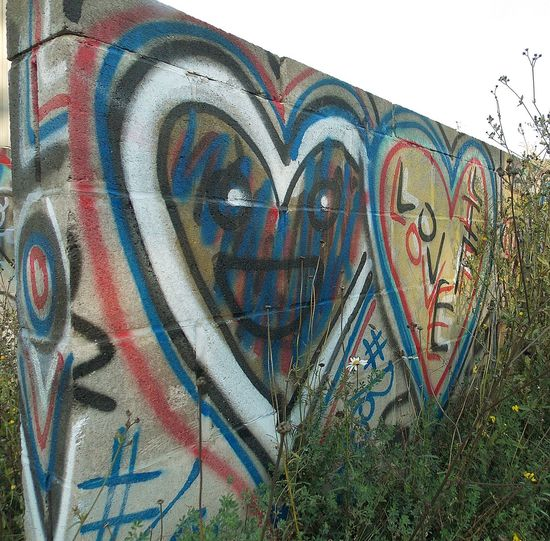 Graffiti Creativity Life Is Reality Because I Can Another Brick In The Wall I See U Two Hearts Beat As One Multi Colored Street Art Mural Nikon L810