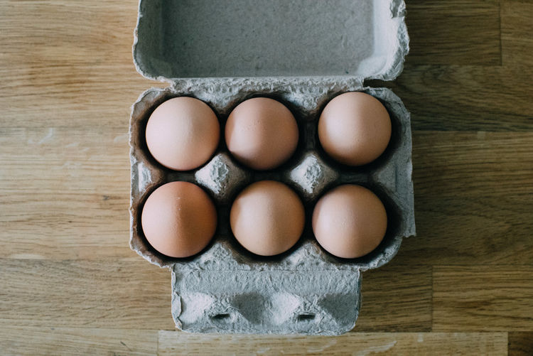 High angle view of eggs in box on table