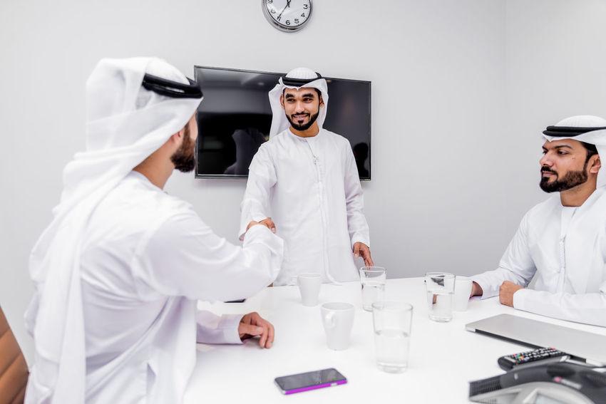 Businessmen meeting in an office in Dubai Arabian Brainstorming Business Dubai Meeting Middle East Office Teamwork UAE Arabic Arabic Style Businessmen Corporate Emirates Emirati Gulf Kandora Kandura Men Talk Team