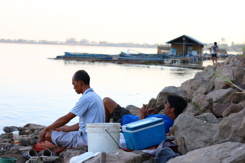 Mekong River NongKhai,ThaiLand Architecture Beach Clear Sky Country Life Countryside Day Leisure Activity Nature Outdoors People Real People Rear View Rock - Object Sitting Sky Still Still Life Two People Water