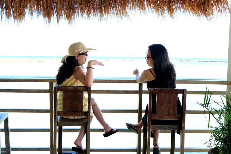 Two People Young Adult Togetherness Young Women Adults Only Heterosexual Couple Adult Young Couple Young Men Women People Only Women Love Vacations Enjoyment Day Relaxation Sitting Bonding Leisure Activity Conversing Be. Ready.