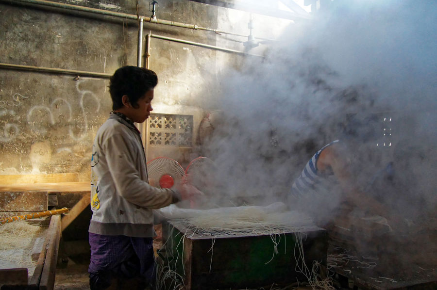 Traveling in the Shan state of Myanmar, Factory worker Shan State Day Heat - Temperature Holding Indoors  Men Myanmar One Person People Preparation  Protective Workwear Real People Standing Steam Working