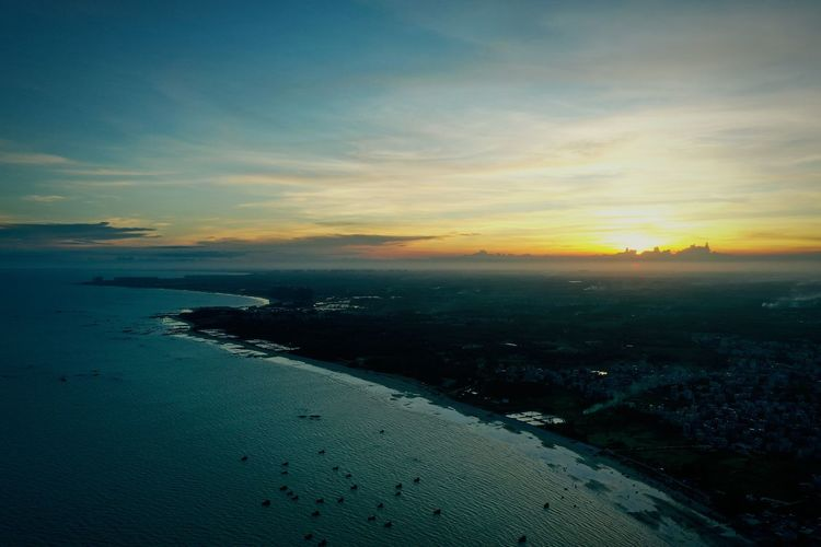 High angle view of sea against sky during sunset