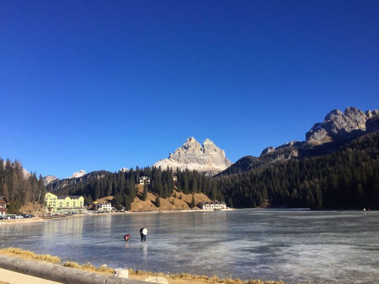 Water Blue Nature Clear Sky Waterfront Mountain Beauty In Nature Tranquility Outdoors Scenics Lake Day Real People Men Tree Sky People Winter Ghiaccio Ice Lagodimisurina Italy