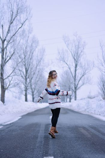 Full Length One Person Snow Only Women Winter One Woman Only Cold Temperature Jogging Road Tree Young Adult Nature Outdoors Adults Only One Young Woman Only People Bare Tree Women Real People Motion Romania Fashion Beauty Nature