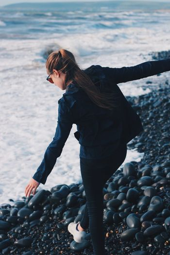 Place Of Heart One Person Beach Outdoors Day Young Women Pebble Sea Nature Lifestyles Water Women Sky Pebble Beach People Jeans Long Hair Casual Clothing Beach Photography Tumblr Waves, Ocean, Nature Waves Crashing Waves And Rocks Waves Waves Rolling In