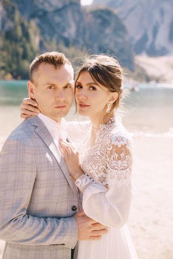 Portrait of bridegroom standing on beach